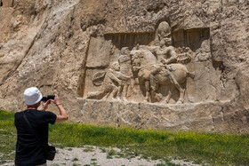 carved reliefs of Naqsh-e Rostam are seen in the photo, Fars, Iran, July 2, 2019.