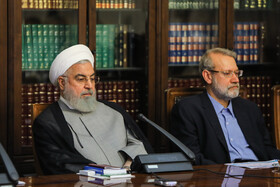 Iranian President Hassan Rouhani (L) and Iranian Parliament Speaker Ali Larijani are present in the session of Supreme Council of Cultural Revolution, Tehran, Iran, July 9, 2019.