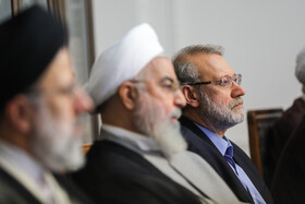 Iranian President Hassan Rouhani (M) and Iranian Parliament Speaker Ali Larijani (R) are present in the session of Supreme Council of Cultural Revolution, Tehran, Iran, July 9, 2019.