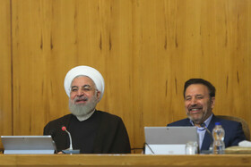 """Iranian President Hassan Rouhani (L) and his Chief of Staff Mahmoud Vaezi are present in Iran's cabinet session, Tehran, Iran, July 10, 2019. During this session, Iranian President Hassan Rouhani described the United Kingdom's seizure of Iranian tanker a childish, cheap and wrong move, and said, """"The British are the initiator of insecurity in seas and we hope that they do not repeat this, because it will spread insecurity throughout the world, and to everybody's detriment""""."""