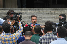 """Iranian President's Chief of Staff Mahmoud Vaezi answers the questions of correspondents on the sidelines of Iran's weekly cabinet session, Tehran, Iran, July 10, 2019. During this session, Iranian President Hassan Rouhani described the United Kingdom's seizure of Iranian tanker a childish, cheap and wrong move, and said, """"The British are the initiator of insecurity in seas and we hope that they do not repeat this, because it will spread insecurity throughout the world, and to everybody's detriment""""."""