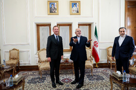 Meeting between Iranian Foreign Minister Mohammad Javad Zarif (M) and French President's top diplomatic advisor Emmanuel Bonne (L), Tehran, Iran, July 10, 2019.