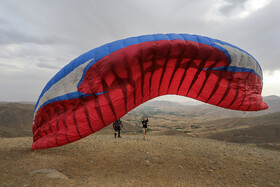 People go paragliding in Hamedan, Iran, July 24, 2019.