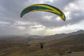 People go paragliding in Hamedan, Iran, July 24, 2019. Nearly 100 paragliders of this western province of Iran do their favorite sport at these paragliding sites during days which are ideal for going paragliding.