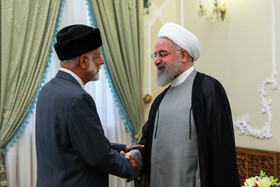 Omani Foreign Minister Yusuf bin Alavi (L) is welcomed by Iranian President Hassan Rouhani before their meeting starts, Tehran, Iran, July 28, 2019.