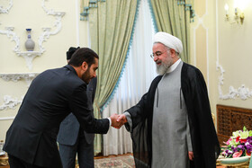 A member of Omani delegation is welcomed by Iranian President Hassan Rouhani (R), Tehran, Iran, July 28, 2019.