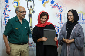 Actress Leili Rashidi (M) is honored during the ceremony of Iran Cinema Celebration, Tehran, Iran, July 29, 2019. The Iranian House of Cinema organizes the celebration every year to commemorate Iran's National Day of Cinema, which is on September 12.