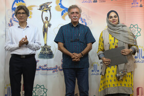 Director Naregs Abyar (R) is honored during the ceremony of Iran Cinema Celebration, Tehran, Iran, July 29, 2019. The Iranian House of Cinema organizes the celebration every year to commemorate Iran's National Day of Cinema, which is on September 12.