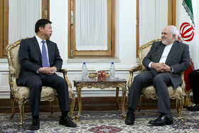 Meeting between the head of the International Liaison Department of the Communist Party of China Song Tao (L) and Iranian Foreign Minister Mohammad Javad Zarif, Tehran, Iran, July 30, 2019.