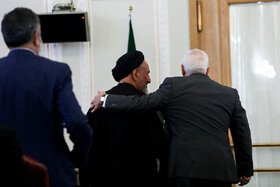 """Iranian Foreign Minister Mohammad Javad Zarif (R) is seen before attending a news conference with international and local media, Tehran, Iran, August 5, 2019. During the press conference with international and local media, Iranian Foreign Minister said, """"Iran will never purchase its security and progress. Our security and progress stem from our own people. No matter how much pressure they put on us, we walked on our own path and succeeded because we relied on our people""""."""