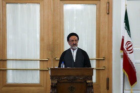 """Iranian politician mahmoud Doaei delivers a speech in the presence of Iranian Foreign Minister Mohammad Javad Zarif, Tehran, Iran, August 5, 2019. During the press conference of Iranian Foreign Minister with international and local media, Mr Zarif said, """"Iran will never purchase its security and progress. Our security and progress stem from our own people. No matter how much pressure they put on us, we walked on our own path and succeeded because we relied on our people""""."""