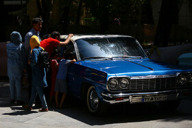 Displaying vintage cars in Isfahan