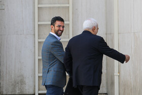 """Iranian ICT Minister Mohammad Javad Azari Jahromi (L) and Iranian Foreign Minister Mohammad Javad Zarif are seen on the sidelines of Iran's weekly cabinet session, Tehran, Iran, August 14, 2019. Speaking on Wednesday in a cabinet session, President Hassan Rouhani said, """"All propaganda about a new coalition in the Persian Gulf and the Sea of Oman are impractical and superficial. Without a doubt, if a part of this propaganda is put into action, they will not be beneficial for the security of the region""""."""