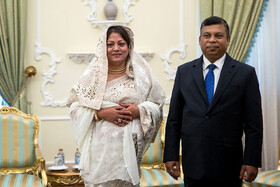 New Bangladeshi ambassador in Tehran (R) is seen on the sidelines of his meeting with Iranian President Hassan Rouhani, Tehran, Iran, August 18, 2019.
