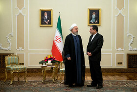 Iranian President Hassan Rouhani (L) is seen on the sidelines of his meetings with new ambassadors in Tehran, Iran, August 18, 2019.