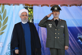 Iranian President Hassan Rouhani (L) and Iran's Defense Minister, Brigadier General Amir Hatami, are present during the unveiling ceremony of Bavar-373 air defense system, Tehran, Iran, August 22, 2019.
