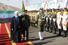 Iranian President Hassan Rouhani (L) and Iran's Defense Minister, Brigadier General Amir Hatami (M), are present during the unveiling ceremony of Bavar-373 air defense system, Tehran, Iran, August 22, 2019.