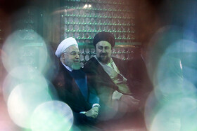 Iranian President Hassan Rouhani (L) and his cabinet Ministers renew allegiance to Imam Khomeini's lofty ideals concurrent with the National Government Week, Imam Khomeini's Mausoleum, Tehran, Iran, August 24, 2019.