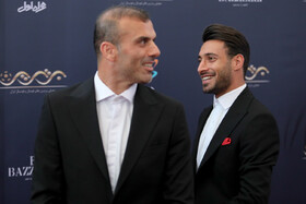 Football player Jalal Hosseini (L) is present in the award ceremony for bests of Iran's football, futsal and beach soccer, Tehran, Iran, August 24, 2019.