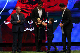 Persepolis goalkeeper Alireza Beiranvand (M) wins awards of best football player as well as best goalkeeper of the previous Persian Gulf League during the award ceremony for bests of Iran's football, futsal and beach soccer, Tehran, Iran, August 24, 2019.