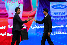 Persepolis goalkeeper Alireza Beiranvand (R) wins awards of best football player as well as best goalkeeper of the previous Persian Gulf League during the award ceremony for bests of Iran's football, futsal and beach soccer, Tehran, Iran, August 24, 2019.