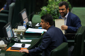Iranian MP Mohammad Azizi (L), the representative of Abhar City, is seen during the public session of Iran's Parliament, Tehran, Iran, August 25, 2019.