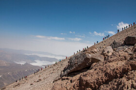 A group of mountain climbers descend Mount Damavand, Iran, August 26, 2019.