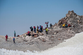Mountain climbers are happy to ascend Mount Damavand, Iran, August 26, 2019.