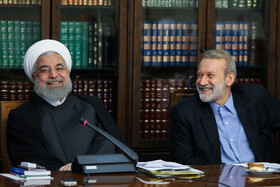 Iranian President Hassan Rouhani (L) and Iranian Parliament Speaker Ali Larijani are present in the meeting of the Supreme Council of Cyberspace, Tehran, Iran, August 31, 2019.