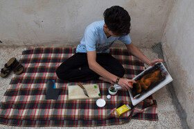 Farhad, an Afghan emigrant who lives in Mashhad City and draws graffiti, prepares to draw his graffiti, Mashhad, Iran, September 1, 2019.