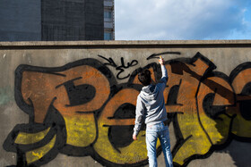 Farhad, an Afghan emigrant who lives in Mashhad City, draws graffiti, Mashhad, Iran, September 1, 2019. Graffiti, which means drawings or writing on a wall, etc. in a public place, conveys political, social and cultural messages.