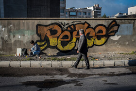 Farhad, an Afghan emigrant who lives in Mashhad City, draws graffiti, Mashhad, Iran, September 1, 2019.