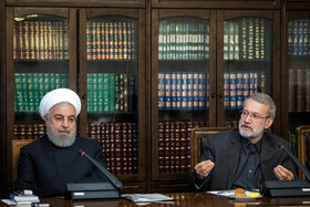 Iranian President Hassan Rouhani (L) and Iranian Parliament Speaker Ali Larijani are seen in the session of Supreme Council of Economic Cooperation, Tehran, Iran, September 14, 2019.