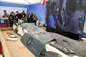 Wreckage from Northrop Grumman RQ-4 Global Hawk is on display in the first exhibition of intruding drones, seized by Iranian Armed Forces, Tehran, Iran, September 21, 2019.