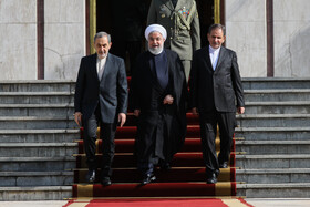 Iranian President Hassan Rouhani (M) is seen off by the senior advisor of Iran's Leader Ali Akbar Velayati (L) and Iranian First-Vice President Es'haq Jahangiri before leaving Tehran for New York, Tehran, Iran, September 23, 2019. Iranian President will attend the 74th United Nation General Assembly in New York.