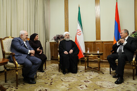 Iranian President Hassan Rouhani (M) and Iranian Foreign Minister Mohammad Javad Zarif (L) are seen in a meeting with Armenian President Armen Sarkissian, Yerevan, Armenia, September 30, 2019.