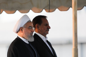 Iranian President Hassan Rouhani (L) is seen off by Iranian First-Vice President Es'haq Jahangiri (R) before traveling to Armenia, Tehran, Iran, September 30, 2019.