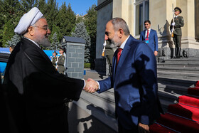 Iranian President Hassan Rouhani (L) is welcomed by Armenian Prime Minister Nikol Pashinyan before their meeting on the sidelines of the Eurasian Economic Council's summit, Yerevan, Armenia, October 1, 2019.