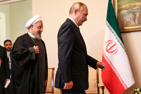 Iranian President Hassan Rouhani (L) and Russian President Vladimir Putin are seen before their meeting starts on the sidelines of the Eurasian Economic Council's Summit, Yerevan, Armenia, October 1, 2019.