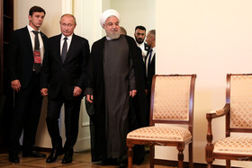Iranian President Hassan Rouhani and Russian President Vladimir Putin are seen before their meeting starts on the sidelines of the Eurasian Economic Council's Summit, Yerevan, Armenia, October 1, 2019.