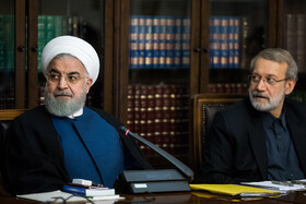 Iranian President Hassan Rouhani (L) and Iranian Parliament Speaker Ali Larijani are present in the meeting of the Supreme Council of Cyberspace, Tehran, Iran, October 5, 2019.