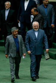 Iranian Foreign Minister Mohammad Javad Zarif (R) is seen on the sidelines of Iran's Parliamentary session, Tehran, Iran, October 6, 2019. Mr Zarif attended the Parliamentary session for answering MPs' questions.