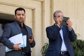 Iran's government spokesman Ali Rabiei (R) is seen on the sidelines of the session of Iran's cabinet ministers, Tehran, Iran, October 9, 2019.