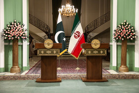On the sidelines of a joint press conference between Iranian President Hassan Rouhani and Pakistani Prime Minister Imran Khan, Tehran, Iran, October 13, 2019.