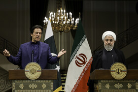 Pakistani Prime Minister Imran Khan (L) delivers a speech in his joint press conference with Iranian President Hassan Rouhani, Tehran, Iran, October 13, 2019.