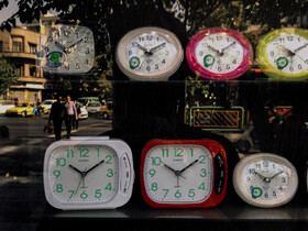 The reflection of people in the display window of a clock shop in Enghelab Street is seen in the photo, Tehran, Iran, October 13, 2019.
