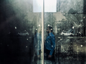 The reflection of a man is seen in the facade of a building, Tehran, Iran, October 13, 2019.