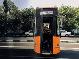 The reflection of a bus in the bus stop shelter is seen in the photo, Vesal Street, Tehran, Iran, October 13, 2019.
