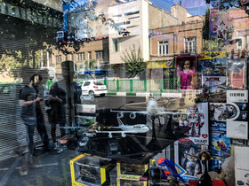 The reflection of people is seen in the display window of a toy store, Tehran, Iran, October 13, 2019.