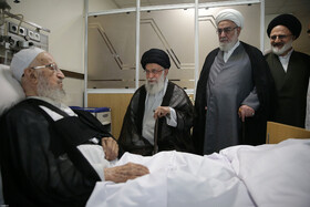 Iran's Supreme Leader Ayatollah Ali Khamenei visits Ayatollah Naser Makarem Shirazi at a hospital in Tehran, Iran, October 14, 2019.